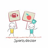 Sports doctor holds a banner with a painted apple and next man holds a poster with a soccer Ball