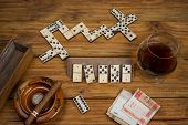 stock photo of cigar  - Top table view on cuban cigar and domino - JPG