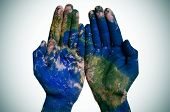 a world map in open man hands (Earth map furnished by NASA)