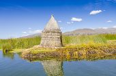 Puno, Peru - hut made from reed on one of floating island Uros, Lake Titicaca