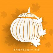Beautiful white pumpkin made from paper on maple leaves decorated yellow background for Happy Thanksgiving Day.