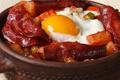 Baked Eggs With Chorizo And Potatoes In A Pot. Macro