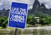 Like The Seasons Things Change sign with a forest background