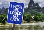 I Wish We Could Go Back sign with a forest background