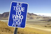 Be True To Who You Are sign with a desert background