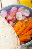 picture of root vegetables  - bowl of steamed root vegetable on a rustic white wood table - JPG