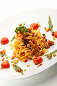 stock photo of pesto sauce  - Vegetarian Tagliatelle with Cherry Tomato and Pesto Sauce - JPG