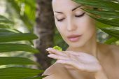 pic of facials  - Beautiful caucasian woman holding natural aloe vera facial gel skin care and wellness - JPG