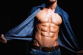 image of strength  - Muscular and sexy body of young man in jeans shirt with perfect abs - JPG