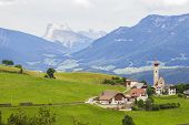 pic of plateau  - Alpine village on a plateau surrounded by mountains Rennon - JPG