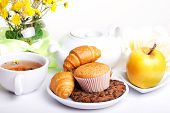 pic of continental food  - continental breakfast with croissants cake chocolate cookies apple and tea - JPG