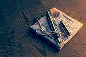 pic of scribes  - Old diary memories with fountain pen on a wooden table - JPG