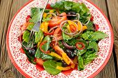 stock photo of onion  - Bright salad with vegetables - JPG