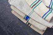 picture of flea  - Old linen cloths in a flea market - JPG