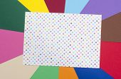 image of paper craft  - Craft paper with color stars on rainbow multicolor paper background - JPG