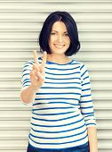 picture of victory  - bright picture of lovely teenage girl showing victory sign - JPG