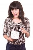foto of unbelievable  - beautiful young happy unbelieving girl holding present wrapped in a box isolated on white - JPG