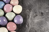 picture of laying eggs  - Illustration of mini eggs laying on a slate table created using median noise reduction - JPG