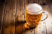 image of alcoholic beverage  - Fresh beer in a glass on wood background - JPG