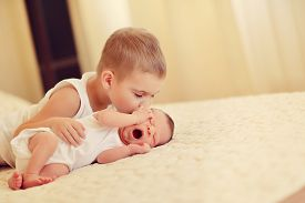 pic of twin baby  - on the bed are two cute little brother the baby sleeps - JPG