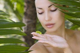 picture of gels  - Beautiful caucasian woman holding natural aloe vera facial gel skin care and wellness - JPG