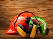 picture of goggles  - Red safety helmet with earphones and goggles - JPG