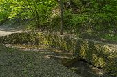 foto of stonewalled  - Stonewall firming creek bed in Golosov ravine in Kolomenskoye park in Moscow - JPG