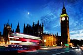 stock photo of london night  - Red bus in motion - JPG