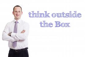 pic of thinking outside box  - Think outside the Box Young businessman with blue text isolated on white background - JPG