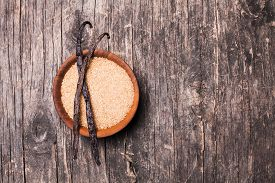 pic of vanilla  - Vanilla sugar in a wooden bowl on a rustic background - JPG
