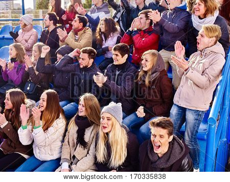 Fans cheering in stadium people