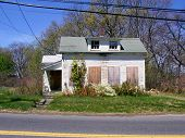 picture of rework  - Small boarded up home on the outskirts of town - JPG