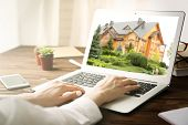 Online shopping concept. Woman looking for house on real estate market website poster
