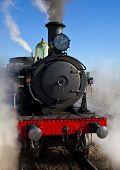 Restored steam locomotive making steam