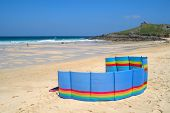 A Colorful Windbreak On Porthmeor Beach, St. Ives, Cornwall, Uk.