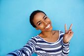 Cool Young Black Woman Taking Selfie With Peace Hand Sign poster