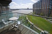balcony on riverside with aluminum garden furniture