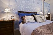 luxury bedroom detail with flower pattern wallpaper
