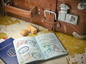 Travel or turism concept.  Old  suitcase  with opened passport with visa stamps. 3d illustration poster