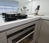 closeup to modern kitchen counter with electric appliances