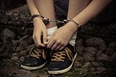 Young Boy In Handcuffs And Sneakers poster