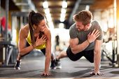 Man and woman strengthen hands at fitness training poster