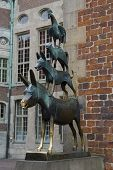 Famous statue in the center of Bremen, Germany, depicting the donkey, dog, cat and cockerel from Gri