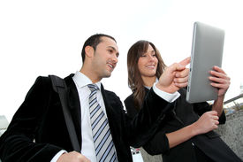 image of computer technology  - Business people meeting outside with electronic tablet - JPG