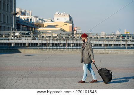 poster of Man Bearded Hipster Travel With Big Luggage Bag On Wheels. Let Travel Begin. Traveler With Suitcase
