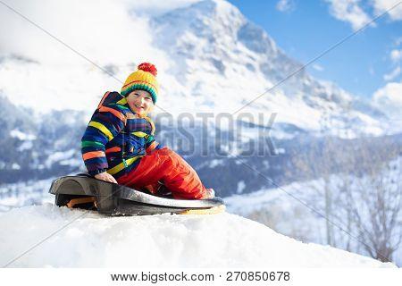 Boy On Sled Ride Child