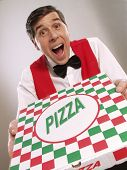 Pizza delivery man holding pizza box . Waiter holding a pizza box.