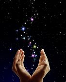 Beautiful hands and the stars