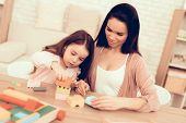 Mother Teaches Daughter. Educational Games. Learning Child At Home. Build House Of Cubes. Cubes And  poster