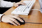 Hand touching computer keys during work